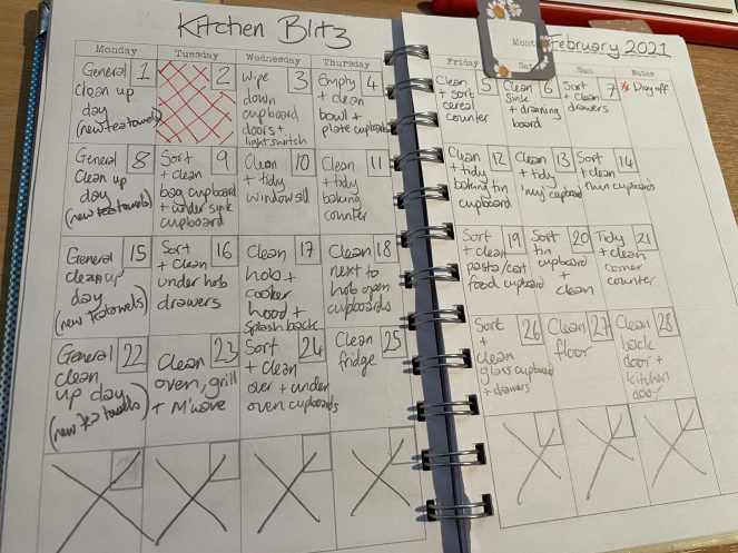 Image of notebook with handwritten cleaning plans on each day.